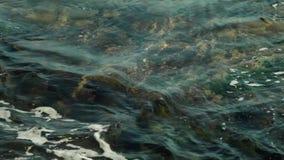 Ocean water flowing through rocks stock footage