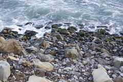 Ocean Water with Rocks and Boulders. Rocks and boulders meet the ocean Stock Image