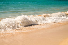 Ocean water at sand beach Stock Photos