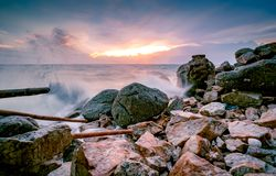 Free Ocean Water Splash On Rock Beach With Beautiful Sunset Sky And Clouds. Sea Wave Splashing On Stone At Sea Shore On Summer. Nature Royalty Free Stock Images - 163819369