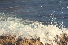 Ocean Water Splashing on Rocks Royalty Free Stock Image