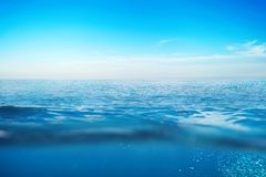 Ocean water with waves. Concept Underwater. Blue ocean water with waves. Concept under water . Horizon royalty free stock image