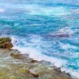 ocean waters and coastal stones Royalty Free Stock Photo