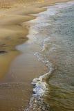 Ocean Wave. On Sandy Beach Background Royalty Free Stock Photo