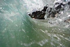 Ocean Wave 3. An ocean wave breaks along the shore of Hawaii Stock Photos