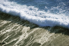 Ocean wave. Is crashing on the shore Stock Image