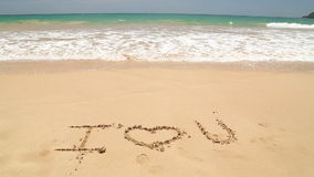 Free Ocean Wave Approaching Words I Love You Written In Sand On Beach Royalty Free Stock Image - 79813726