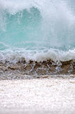 Ocean wave in Baja California Sur, Mexico. A powerful wave pounds the beach in Cabo San Lucas, Mexico. Focus = the white foam. 12MP camera Stock Image