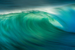 Ocean Wave Barrel. Ocean wave crashing with long exposure to show motion within the wave Stock Photography