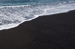 Ocean wave on black sand beach, Lanzarote, Spain Royalty Free Stock Photos