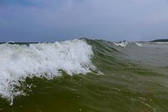 Ocean Wave Blue Water Ocean Wave blue swells crashing curling. Breaking sea water Stock Photo