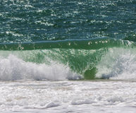 Ocean wave. A breaking wave at the beach Stock Images