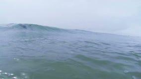 Ocean Wave Breaking on the Beach in California. Filmed from the Water, a Wave Breaking on the Beach in California.  Filmed in Slow Motion at 120fps 720p HD video stock video footage