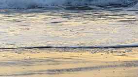 Ocean Wave Breaking on the Beach in Slow Motion Royalty Free Stock Photos
