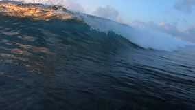 Ocean wave breaking on camera stock video footage
