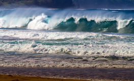 Ocean Wave Breaking Onto Shoreline Royalty Free Stock Images