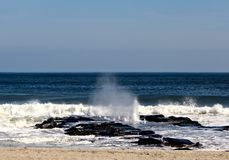 Ocean Wave Breaking Over Jetty Royalty Free Stock Photos