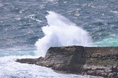 Ocean wave breaking on the rocks. Scotland, Uk Stock Images