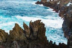Ocean wave breaking sea water rocky shore rough seas turquoise water gradient foam background Porto Moniz Madeira Stock Photos