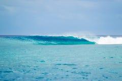 Ocean Wave breaking in splashes. Big Blue Ocean Wave barrel Stock Images