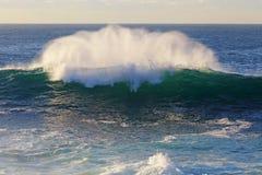 Ocean wave breaks Stock Photo