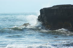 Ocean wave and cliff Stock Photography