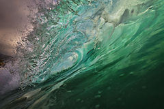 Shorebreak surfing wave at sunset time stock photo