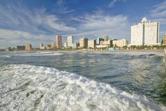 Ocean wave comes in Durban skyline, South Africa on the Indian Ocean Stock Photos