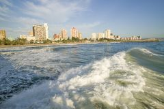 Ocean wave comes in on Durban skyline, South Africa on the Indian Ocean Royalty Free Stock Image