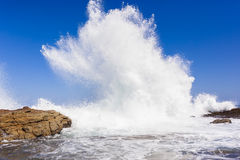 Ocean Wave Exploding Rocks Stock Image