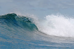 Ocean wave falling down. Rough white blue ocean wave falling down stock images
