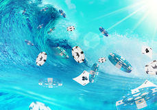 Ocean Wave and Flying Gambling Chips. Stock Photos