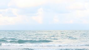 Ocean wave hit the beach, sea waves with wave crashing on sandy shore stock footage