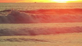 Ocean wave. S during golden sunset stock footage