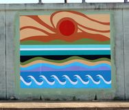 Ocean Wave Pattern Wall Mural On A Bridge Underpass On James Rd in Memphis, Tn. Colorful Sun and Ocean Wave Pattern Mural on a wall on a bridge underpass in royalty free stock image