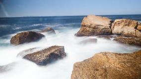 Ocean wave rock Stock Images