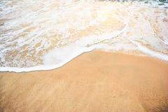 Ocean wave on sandy beach Royalty Free Stock Photos
