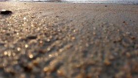 Ocean wave on sandy beach stock footage