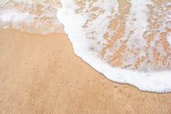 Ocean wave on sandy beach Royalty Free Stock Photography