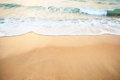 Ocean wave on sandy beach Stock Photos