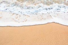 Ocean wave on sandy beach Stock Photography