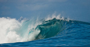 Ocean Wave is screwed into the pipe. Indian Ocean. Stock Photo