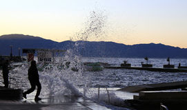Ocean wave splash human silhouette Royalty Free Stock Images