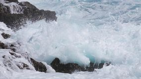 Ocean wave splash on the reef stock video footage