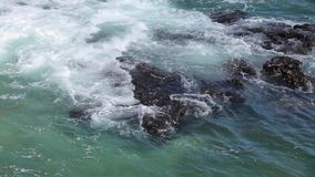 Ocean wave splash on the reef stock footage
