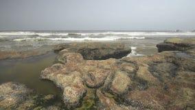 Ocean wave splash on the reef. On Legzira beach in Morocco stock video footage