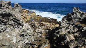 Ocean wave splash on the reef. Video stock video footage