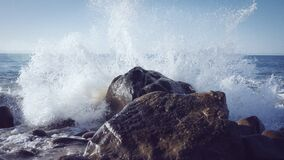 Ocean Wave Splashing Against Rocks Stock Photography