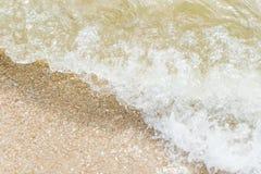 Ocean wave splashing on a brown beach Stock Photos
