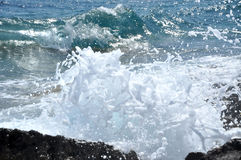 Ocean wave splashing the rocky coast Stock Image